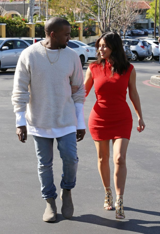 Kim Kardashian and Kanye West arm in arm as they walk into the cinemas to see a movie
